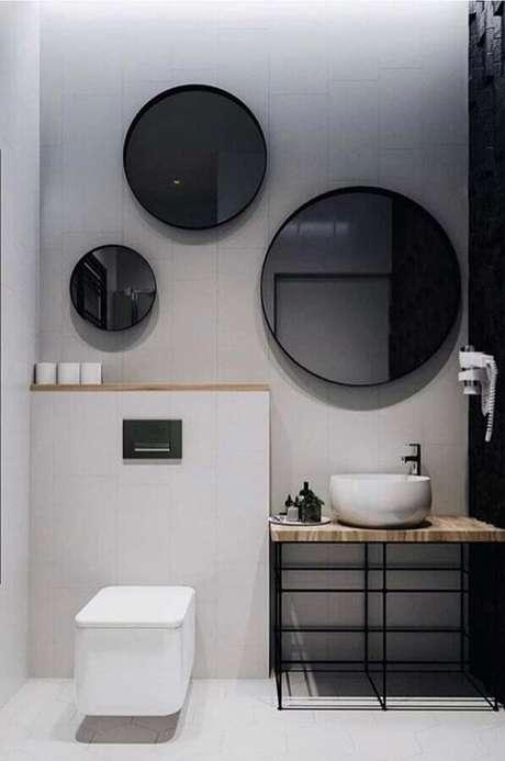33. Decoração moderna com espelhos para banheiro redondo – Foto: Home Fashion Trend