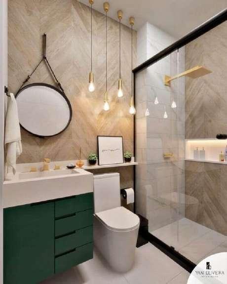 7. O espelho redondo para banheiro com alça de couro é perfeito para decoração contemporânea – Foto: Reciclar e Decorar