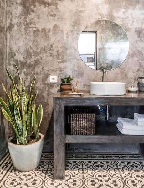 64. Espelho redondo para banheiro rústico decorado com cimento queimado – Foto: Pinterest