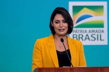 A primeira-dama Michelle Bolsonaro, durante Cerimônia sobre o Dia do Voluntário, no Palácio do Planalto, em Brasília