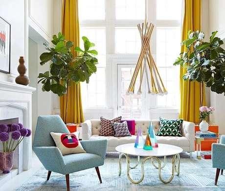 46. Os pés da mesa de centro retrô redonda chama a atenção pelo design arrojado. Fonte: All Modern