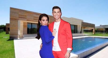 Cristiano Ronaldo e Georgina Rodríguez com a casa de La Finca ao fundo