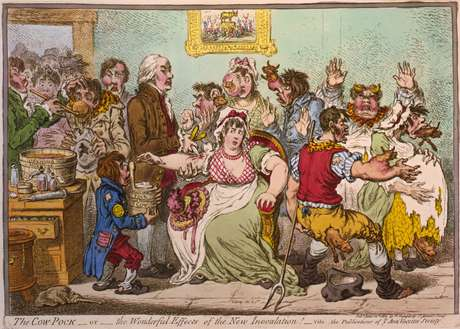 Mal a vacina foi criada, surgiram os idiotas anti-vaxxers. Caricatura de 1802, da Sociedade Anti-Vacina.