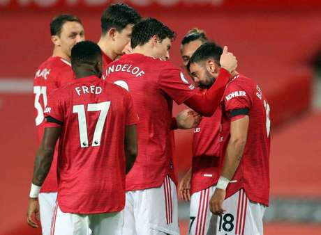 Manchester United chegou aos 13 pontos no Campeonato Inglês (Foto: CATHERINE IVILL / POOL / AFP)