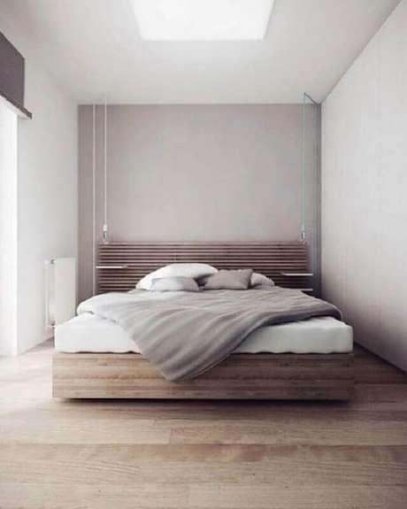 20. Decoração para quarto de casal minimalista com cama de madeira – Foto: Futurist Architecture