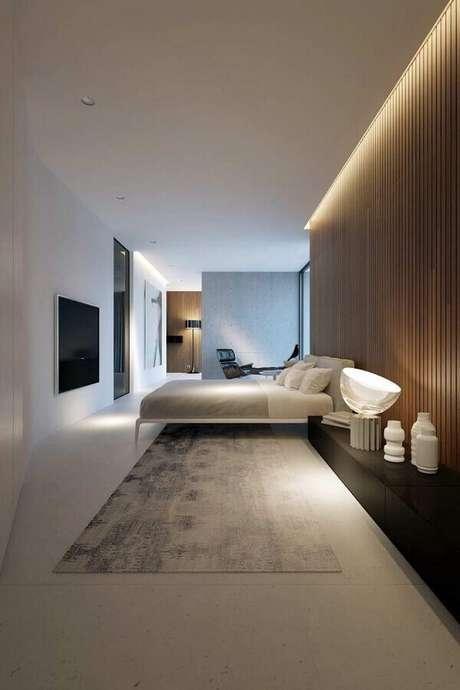 24. Parede de ripas de madeira para decoração de quarto de casal minimalista – Foto: Futurist Architecture