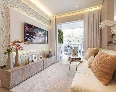 35. Painel 3D para decoração de sala bege pequena – Foto: Dicas de Mulher