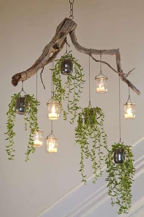 9. Um galho seco serve de suporte para vaso de planta suspenso. Fonte: Pinterest