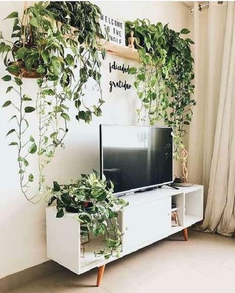 11. Veja como funciona muito bem de decoração da sua sala com vaso suspenso. Fonte: Pinterest