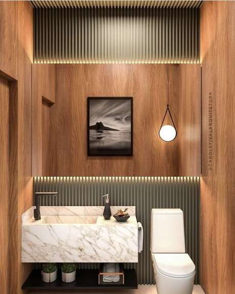 32. Banheiro com revestimento de madeira – Via: Pinterest