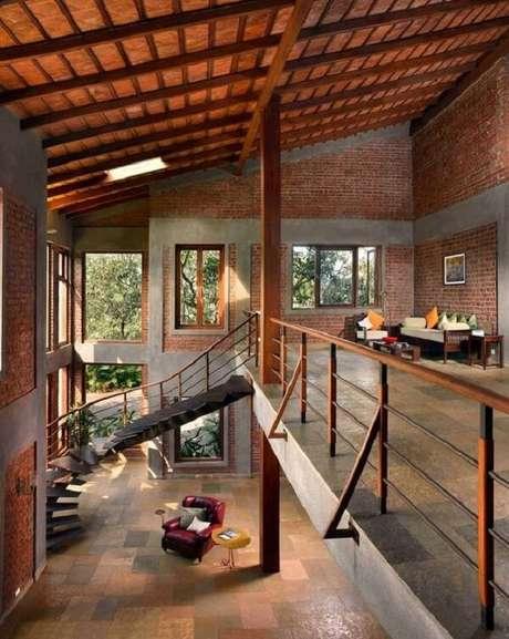 17. A parede com tijolinho aparente deixa a casa com mezanino ainda mais especial. Fonte: Pinterest