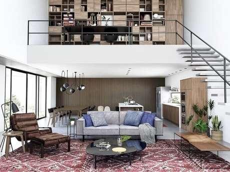 19. Aproveite o espaço embaixo da escada flutuante da casa com mezanino. Fonte: Ana Carolina Baptistella