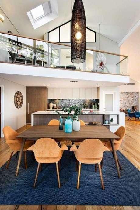 32. Casas com mezanino simples e guarda-corpo de vidro discreto. Fonte: Jodie Cooper Design