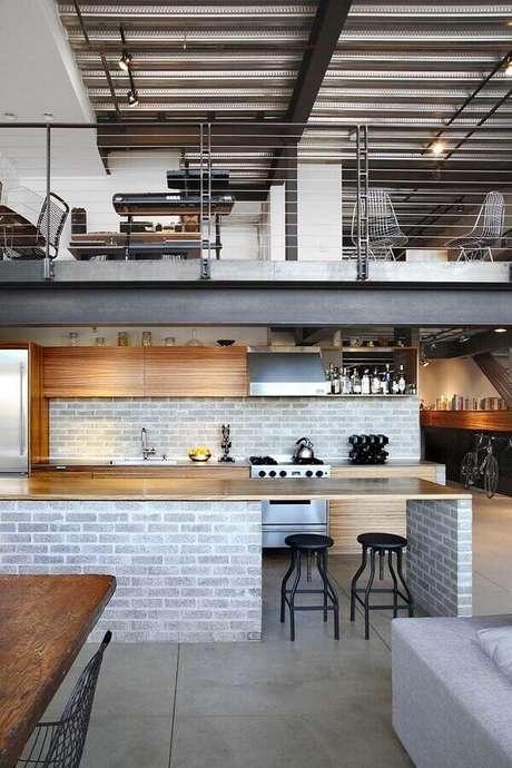 49. Tijolinho cinza para decoração de cozinha estilo industrial com ilha – Foto: Pinterest