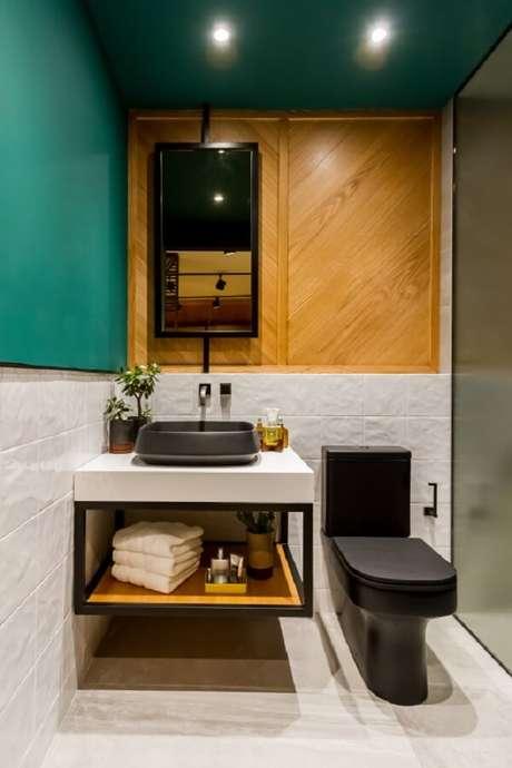 48. A cor da cuba de apoio para banheiro se assemelha ao tom do vaso sanitário. Fonte: Deca – Suite Masculina Lagom – Andrea R. Anez e Branda Jimenez