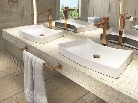 36. Ambiente compartilhado com cuba de apoio para banheiro Deca. Fonte: Deca