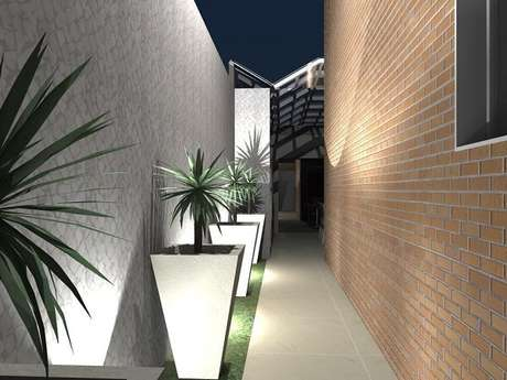 13. A luminária para corredor externo embutir chão é uma alternativa para o jardim. Fonte: Luiza Altman