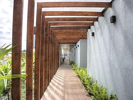 8. Modelo de luminária de parede para corredor externo. Projeto por Studio Scatena Arquitetura