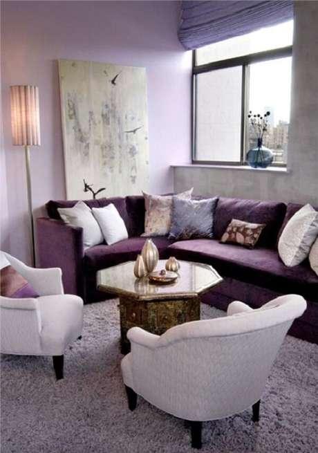 38. O sofá roxo de canto foi a opção perfeita para esse projeto. Fonte: Pinterest