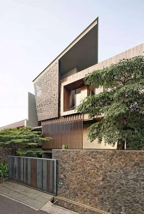 22. Fachada imponente com modelo de muro de pedra. Fonte: Pinterest