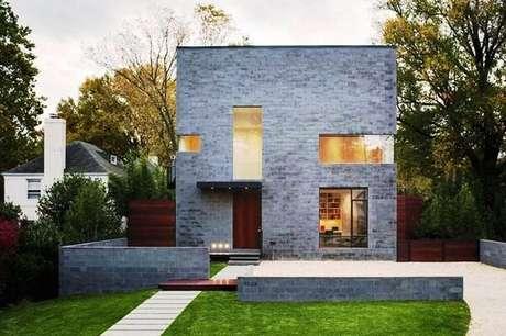 64. Muro feito de concreto aparente reflete estilo industrial. Fonte: Pinterest