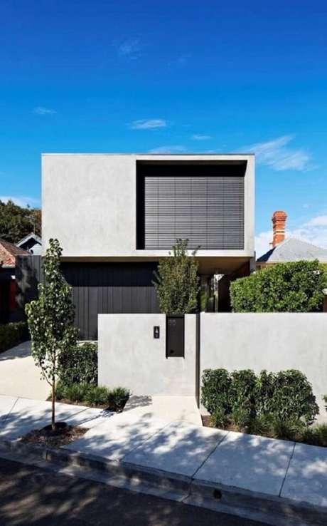 65. Modelo de muro para casa feito em alvenaria e com pintura cinza. Fonte: Pintura