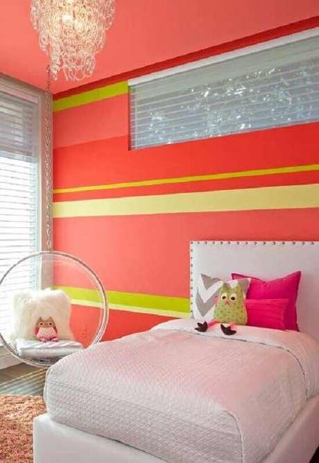 26. Decoração de quarto para criança com parede laranja e amarela – Foto: Pinterest