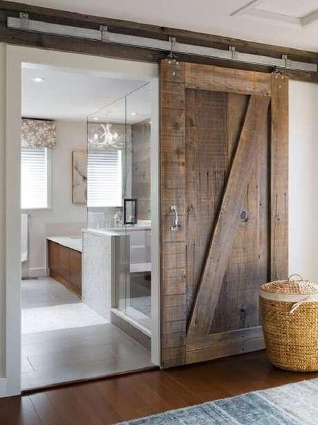 31. Modelo de porta de correr de madeira para quarto para decoração rústica. Fonte: Revista Viva Decora 2