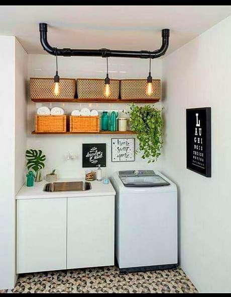 48. Decoração com caixas organizadoras para prateleiras para lavanderia pequena. Foto: Quadrilha Design e Arquitetura