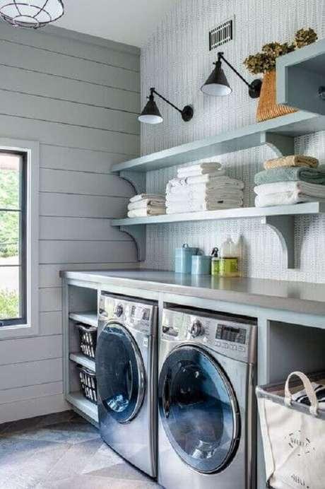 6. Decoração com prateleira para lavanderia planejada. Foto: Houzz