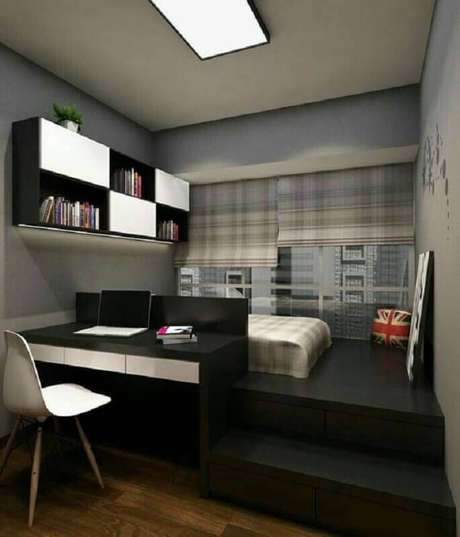 13. Home office no quarto planejado com decoração preta e cinza. Foto: Pinterest