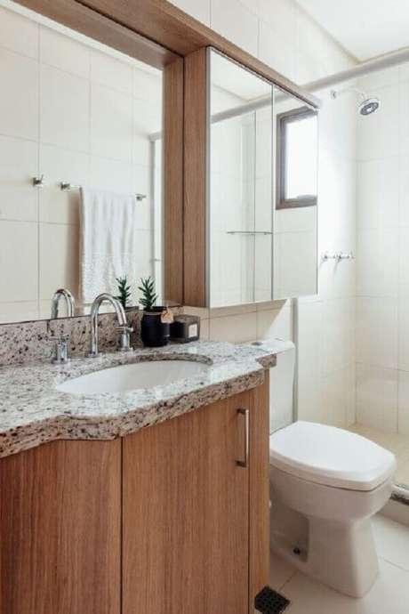 13. Armário espelheira para banheiro planejado com gabinete de madeira – Foto Pinterest