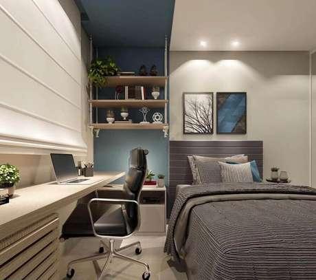 58. Tons de cinza para decoração de home office no quarto moderno. Foto: Eduardo Muzzi