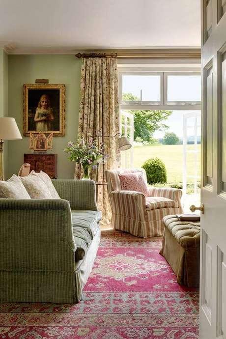 31. Sala vintage com capa de sofá verde – Foto House and Garden