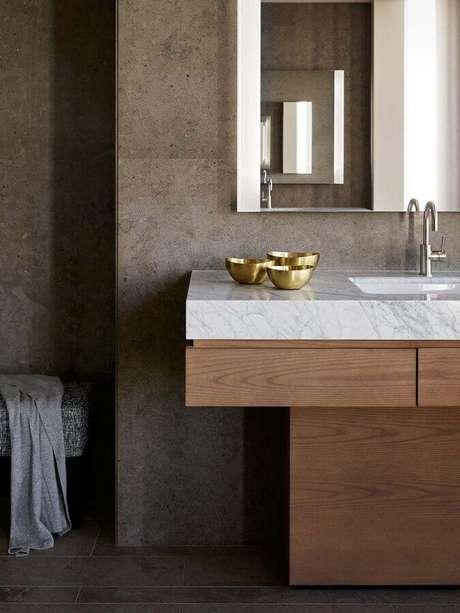 13. Bancada de mármore moderno decorado com gabinete de madeira – Foto Behance