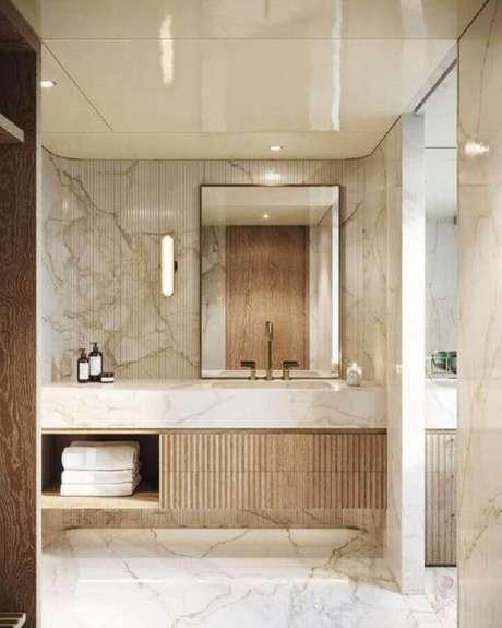 22. Bancada de mármore para banheiro sofisticado decorado em cores neutras – Foto Boca do Lobo