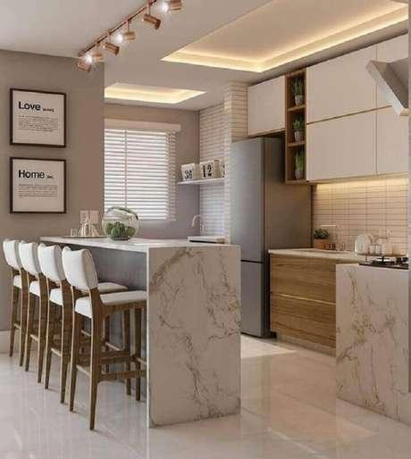 25. Bancada de mármore para decoração de cozinha planejada – Foto Decor Salteado