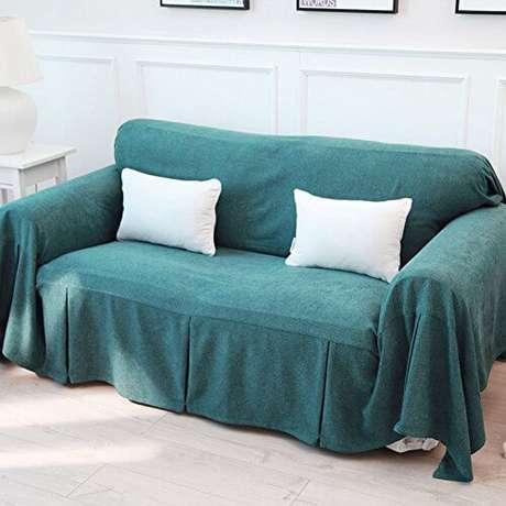 23. Sala com sofá coberto por tecido Foto Want it all