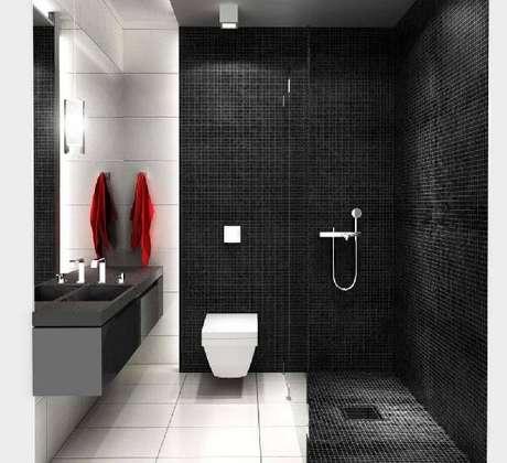 44. A pastilha preta fosca marca presença no revestimento de parede e piso desse banheiro. Fonte: Pinterest