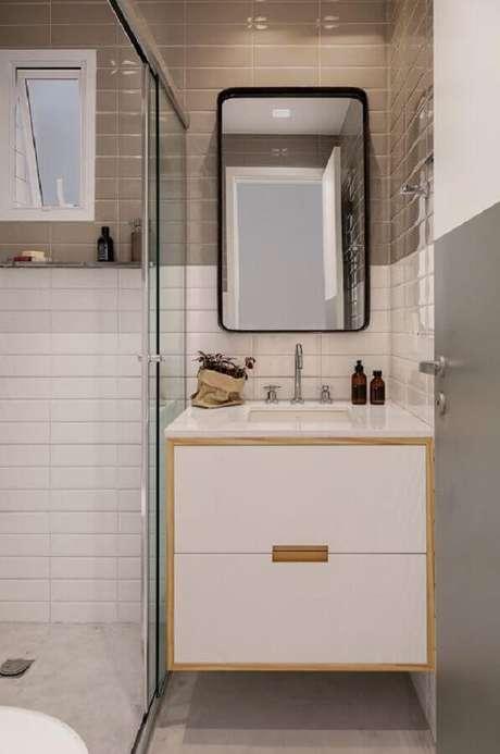 49. Azulejo para parede de banheiro cinza e branco decorado com gabinete suspenso pequeno. Foto: Studio elen saravalli Arquitetura