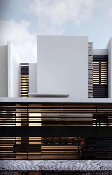 45. Portão de ferro preto vazado combinando com grades na fachada da casa. Foto de Pinterest
