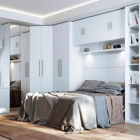 3. Guarda-roupa com cama embutida com acabamento branco. Fonte: Homedock