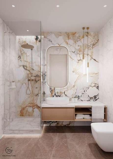 20. Revestimento marmorizado em dourado e cinza – Foto Architecture