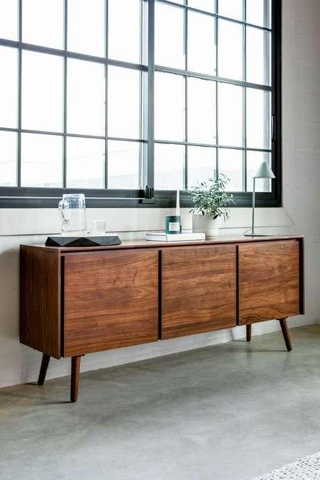 39. Rack pé palito de madeira na sala de estar – Foto Article