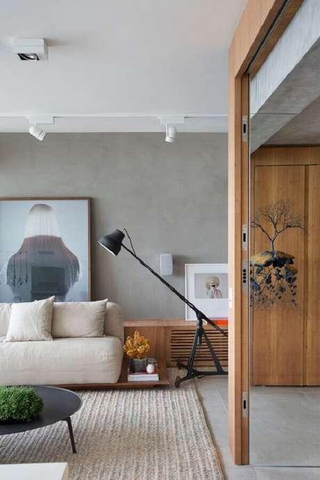 10. Luminária de chão moderna para sala de estar decorada com parede de cimento queimado – Foto Studio Roca
