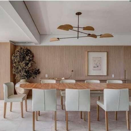 27. Luminária moderna para decoração de sala de jantar amadeirada – Foto Cristiana Bertolucci Estúdio