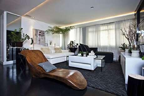 43. Decoração de sala de estar moderna com piso vinilico preto – Foto Futurist Architecture
