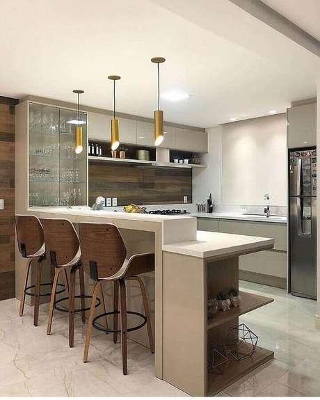 60. Decoração em cores neutras com luminárias modernas para cozinha americana – Foto Decor Salteado
