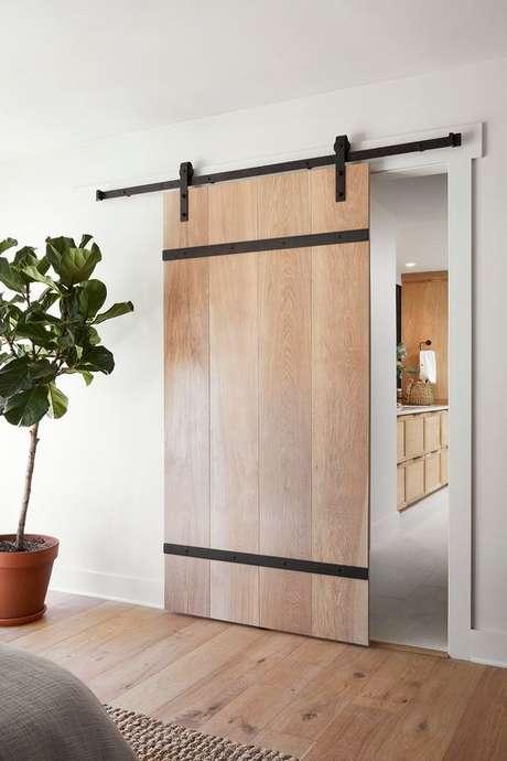 1. Porta de correr de madeira para sala moderna – Foto Magnolia Market