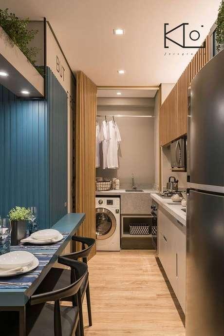 36. Área gourmet azul com armário para lavanderia – Foto Arkpad